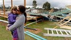 Melissa Short and her four-year-old daughter Ayla stand next to the ruins of their near completed house in the township of Pratten, near Warwick, Queensland.