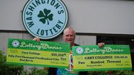 Cary Collings with cheques for his winnings. (Facebook)