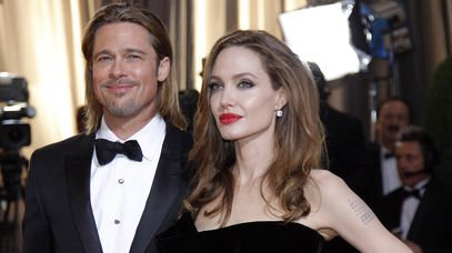 Angelina Jolie (right) with partner Brad Pitt at the Academy 