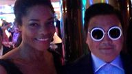 Naomie Harris posted this image on Twitter of herself posing with someone she believed was Psy in Cannes on May 21.