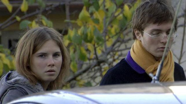 Amanda Knox with Raffaele Sollecito pictured outside the rented house where Meredith Kercher was found dead in Perugia, Italy. (AP)