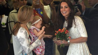 The Duchess of Cambridge, Catherine speaks with a mother and young baby during a visit by The Duke an
