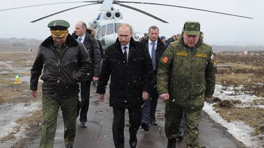 Russian President Vladimir Putin, center, and Defense Minister Sergei Shoigu (left) and the commander of the Western Military District Anatoly Sidorov (right) walk upon arrival to watch military exercise near St.Petersburg, Russia (AAP).