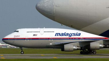 A Malaysia Airlines aircraft taxis past another plane at the KL International Airport. (Getty)