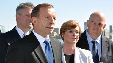 Prime Minister Tony Abbott speaks to the media with Finance Minister Mathias Cormann (left) and Senate candidates Linda Reynolds and Slade Brockman. (AAP)