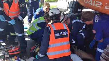 Paramedics assist the injured man. (Careflight)