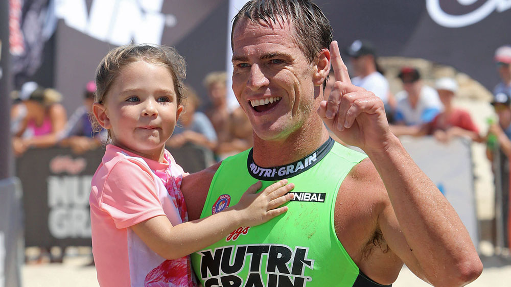Shannon Eckstein celebrates his win with his daughter. (Getty)