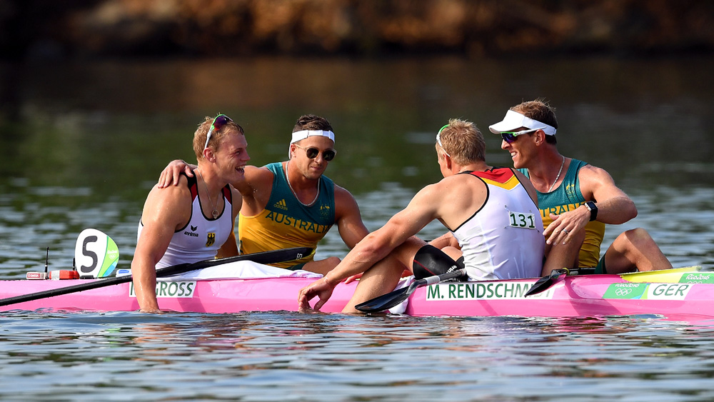 The Australians congratulate the winning German pair. (AAP)