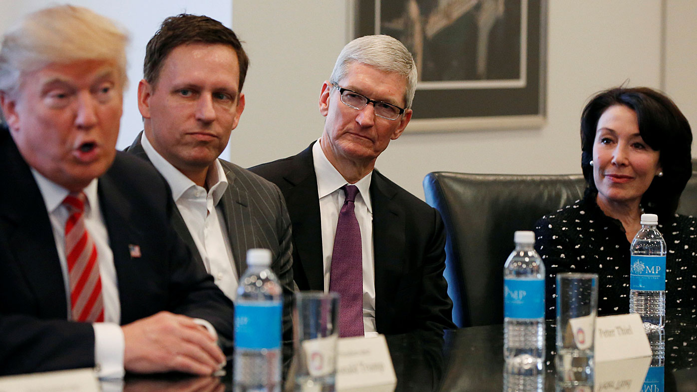 U.S. President-elect Donald Trump speaks as (2nd L to R) PayPal co-founder and Facebook board member Peter Thiel, Apple Inc CEO Tim Cook and Oracle CEO Safra Catz look on during a meeting with technology leaders at Trump Tower in New York. (Reuters)