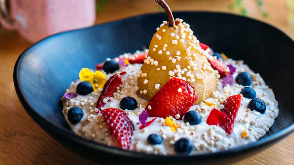 Wild Sage's bircher muesli with poached pears and coconut ...