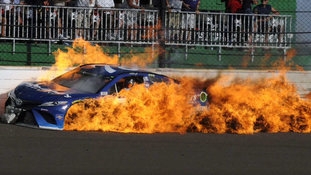Martin Truex Jr's car was engulfed in flames. (AAP)