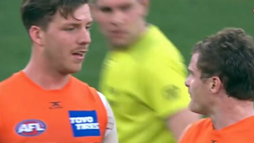 GWS player Heath Shaw (right) lets Aidan Corr know what he thinks about something that took place during the match. (AAP)