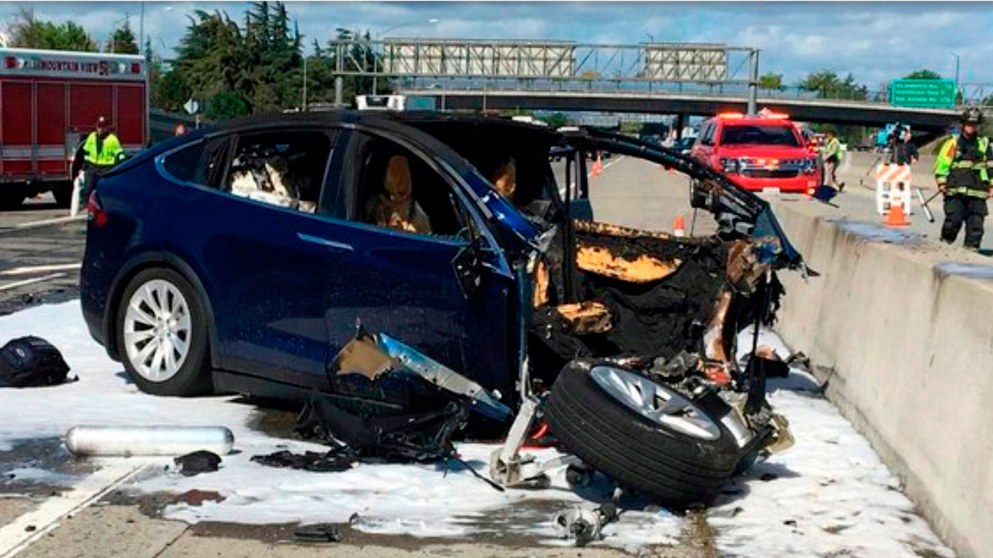 n this March 23, 2018, file photo provided by KTVU, emergency personnel work at the scene where a Tesla electric SUV crashed into a barrier on U.S. Highway 101 in Mountain View, Calif. Federal investigators say the Tesla using the company's semi-autonomous driving system accelerated just before crashing into a California freeway barrier, killing its driver. The National Transportation Safety Board issued a preliminary report Thursday, June 7, on the crash. (KTVU via AP, File)