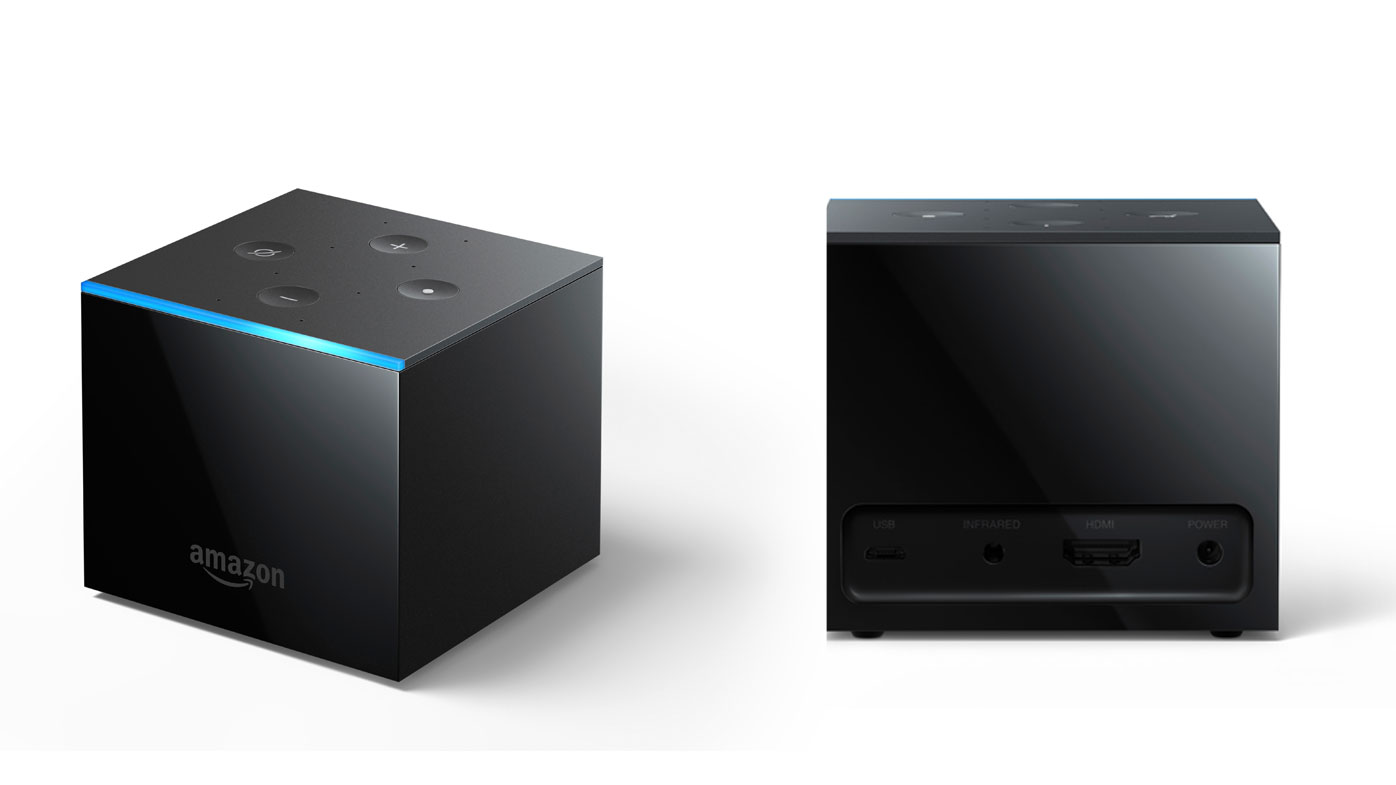 This undated image provided by Amazon.com, Inc. shows an Amazon Fire TV Cube. Amazon unveiled the new voice-controlled Fire TV device, which lets users shout out when they want to turn on the TV, flip channels or search for sitcoms, all without pushing any buttons. But the Fire TV Cube, which will be available later this month for $120, is not entirely hands free. Some apps or streaming services may require viewers to pick up the included remote to rewind or stop a show. (Amazon.com, Inc. via AP)