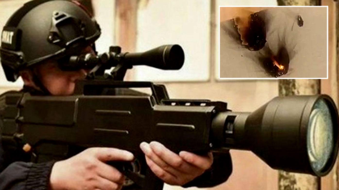 Chinese 'laser' rifle test firing shows burning targets
