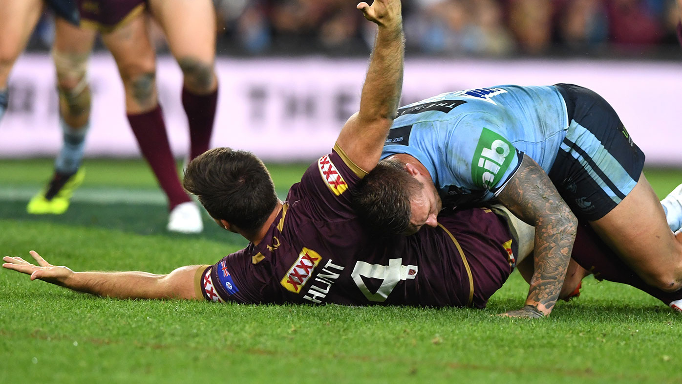 Ben Hunt is tackled by Tariq Sims during Origin III