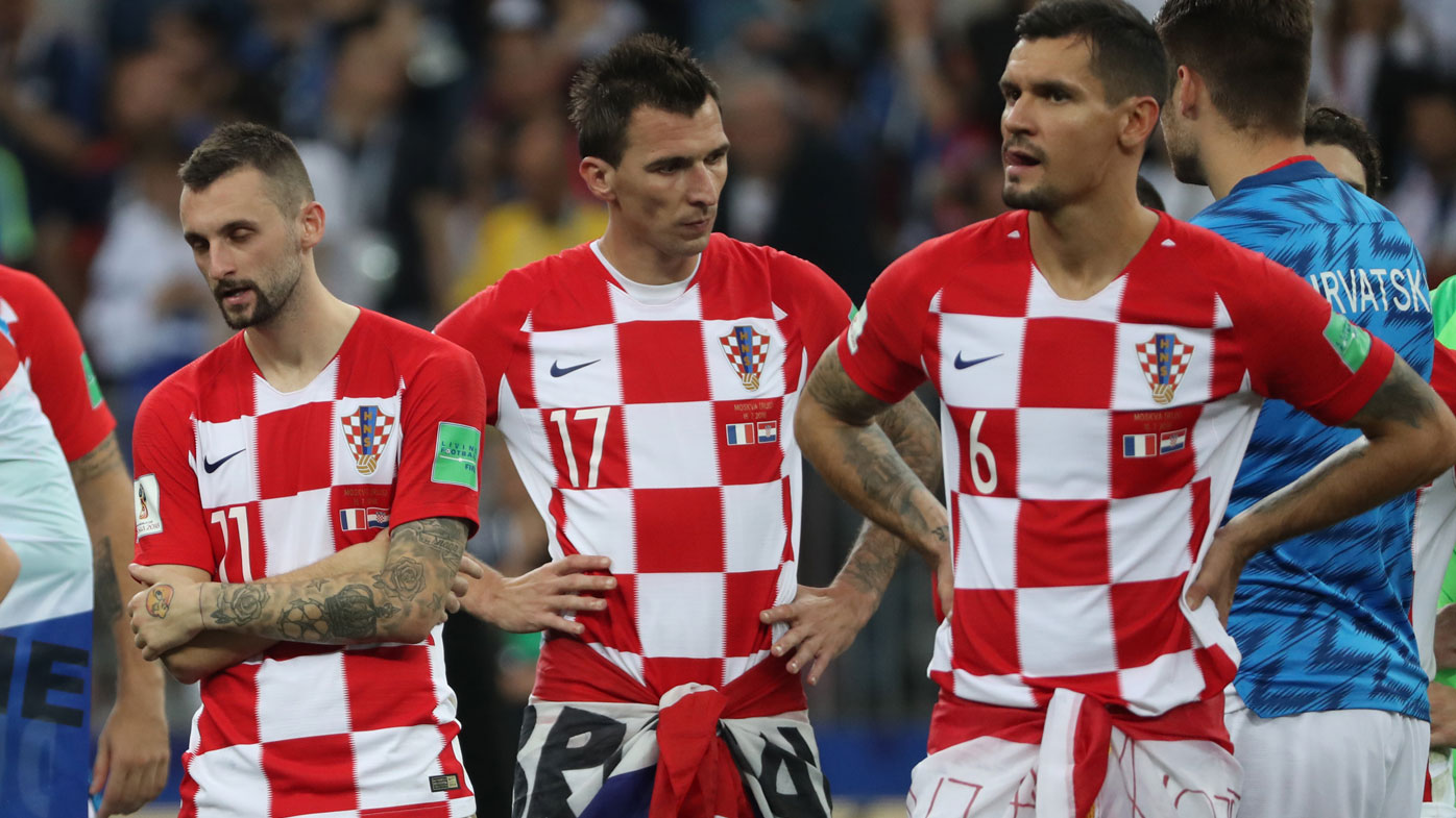 Mario Mandzukic (centre) comes to terms with Croatia's loss.
