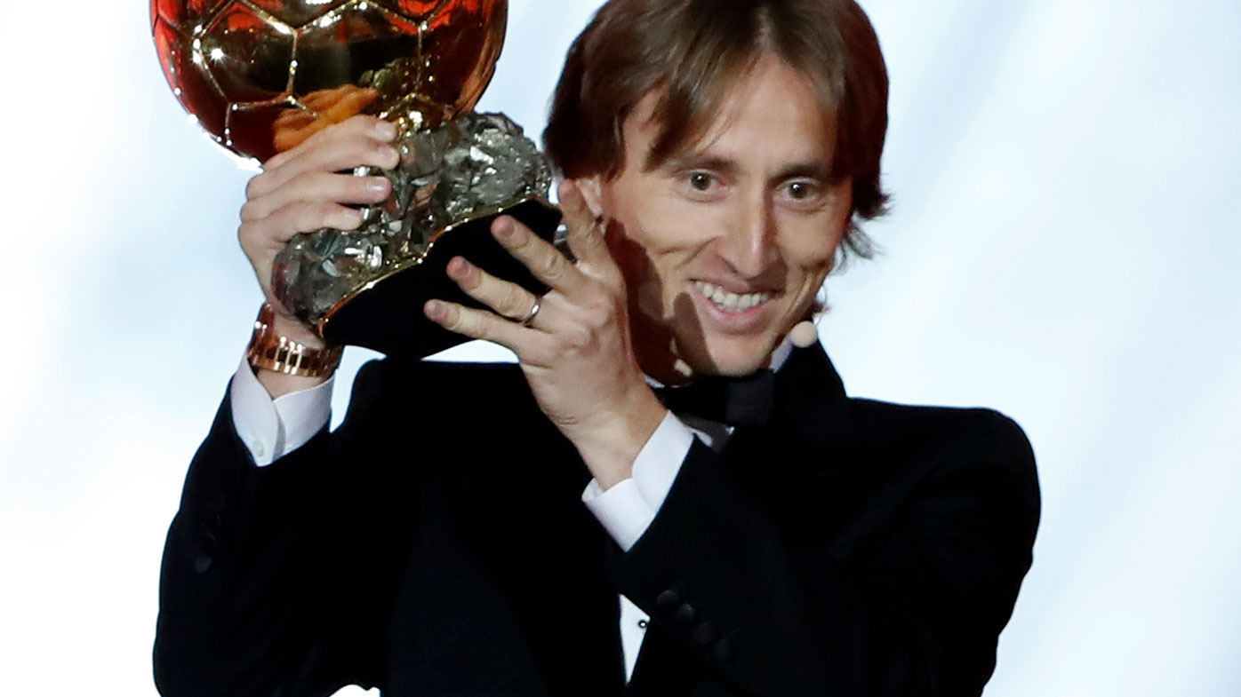 Real Madrid's Luka Modric celebrates with the Ballon d'Or award.
