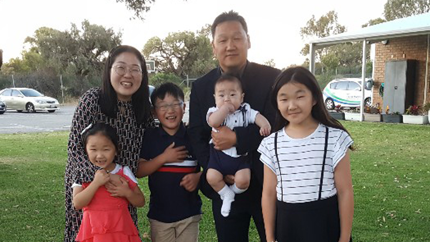 Mi Young Lee (pictured with her family) was scammed out of $17,000 after clicking on a dodgy text.