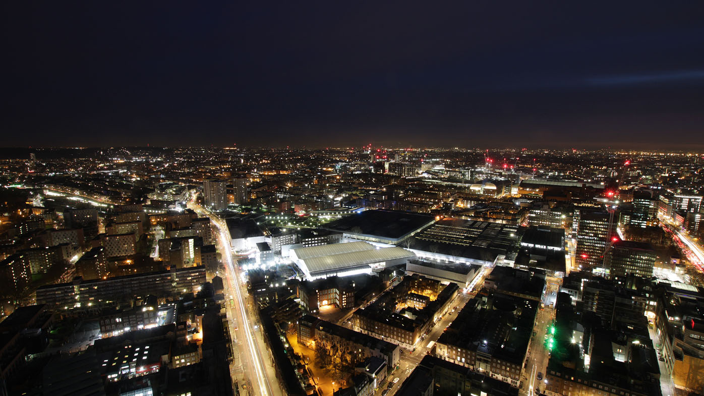 The massive dig site can be seen lit up at night.