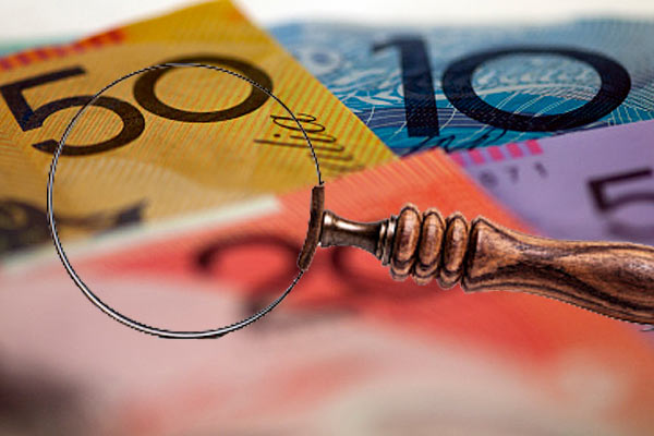 Australian money, magnifying glass