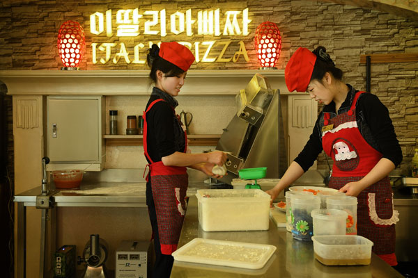 North Korean workers making pizza in up-scale pizza restaurant (Getty Images)