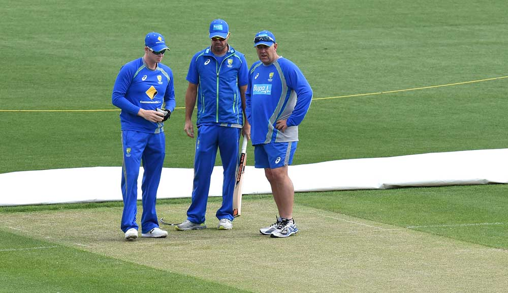 Steve Smith inspects the Hobart pitch. (AAP)