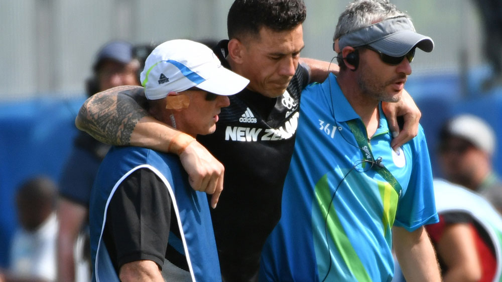 Sonny Bill Williams is helped off the field. (AFP)