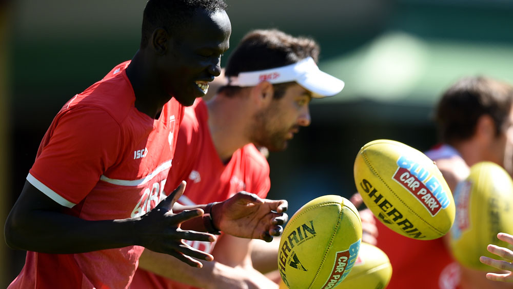 Aliir Aliir does some handball drills during training. (AAP)