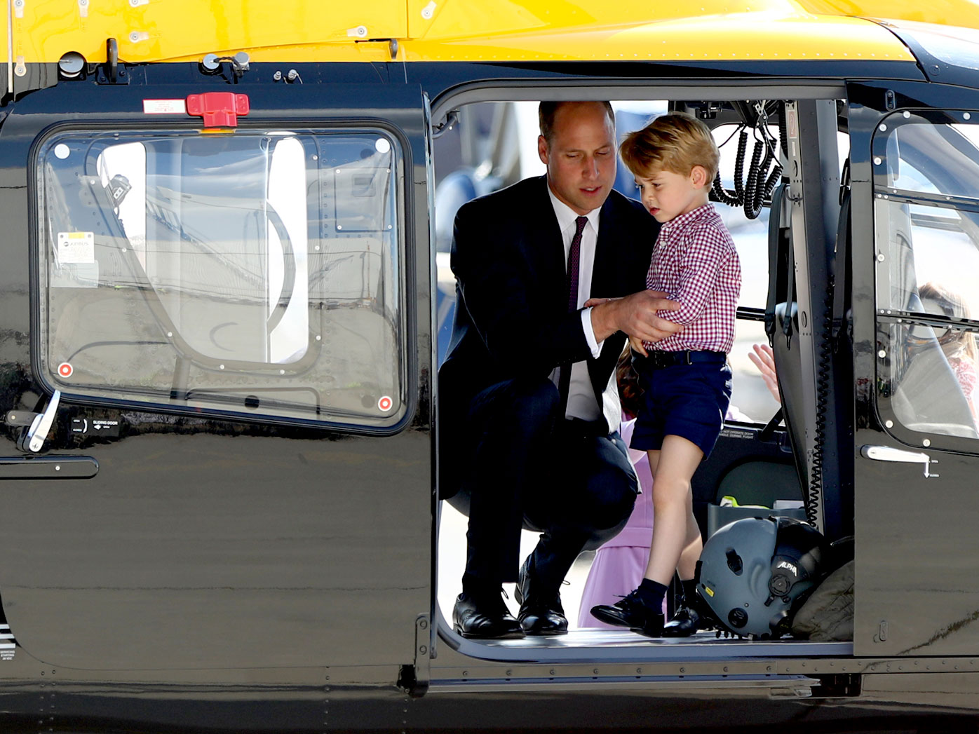 Prince George explores a helicopter with his father during a royal tour of Poland and Germany this month. (AAP)