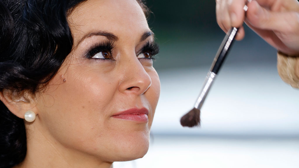 Christie has her make up touched up before her walk down the aisle.