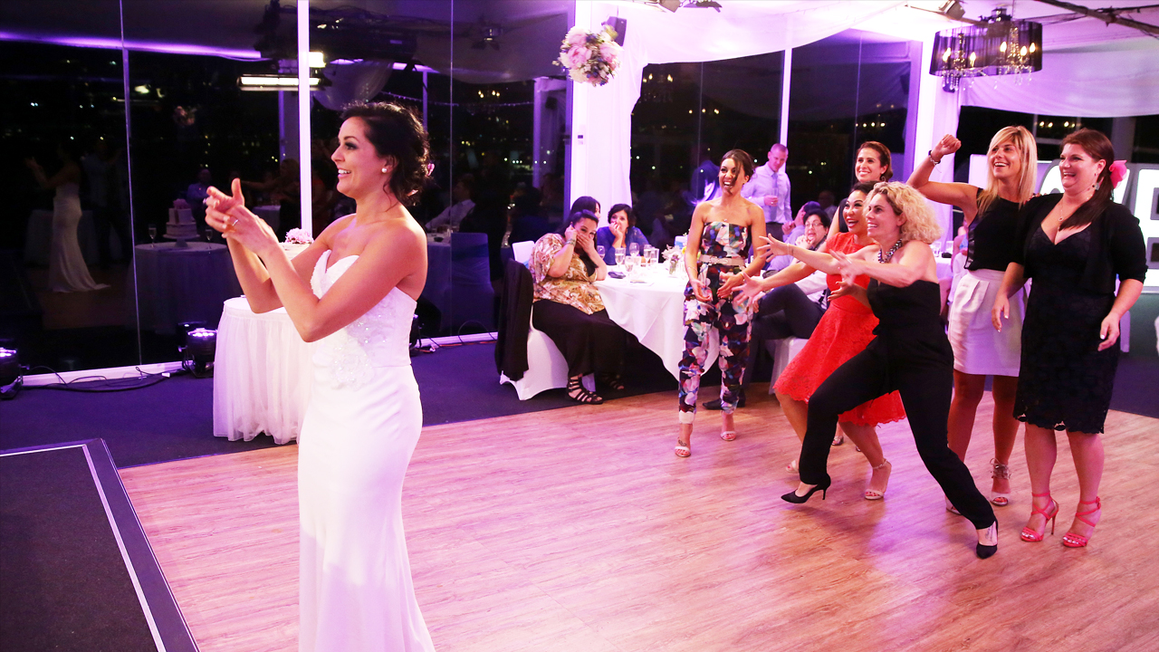 Christie chucks her bouquet at a very keen bridal party.