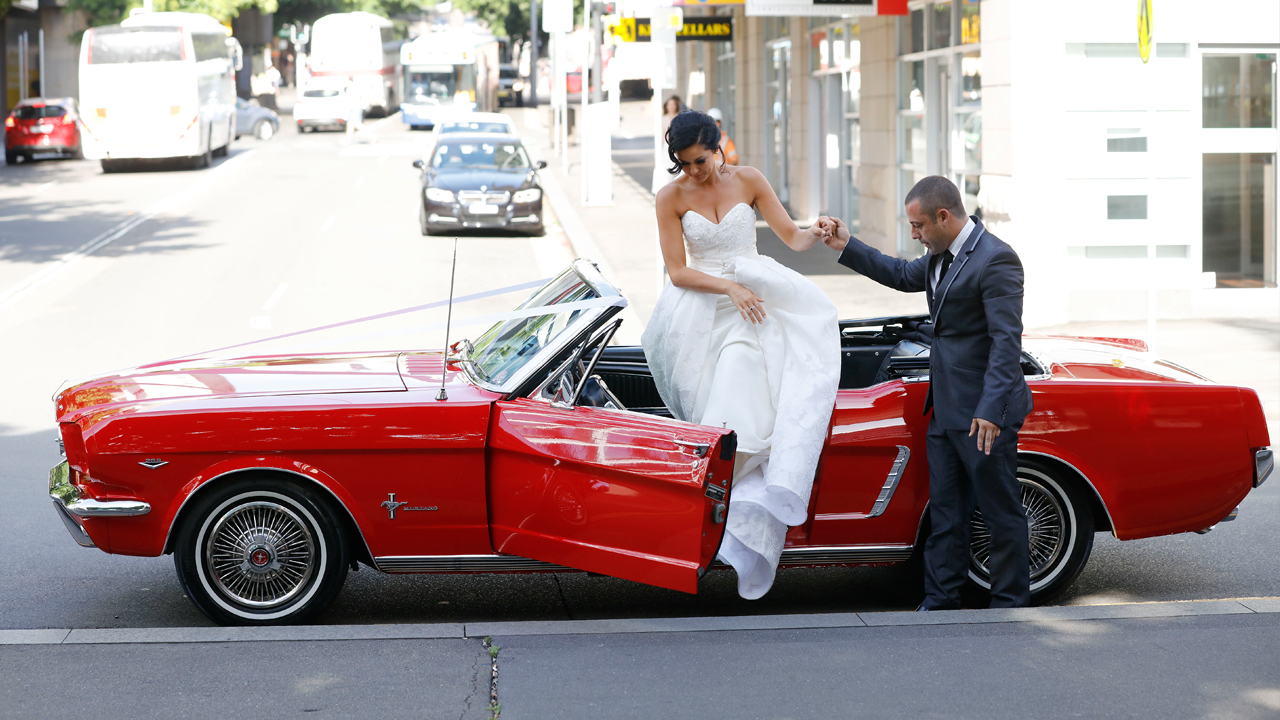 Christie is helped out of her Mustang as she makes her way to the altar.