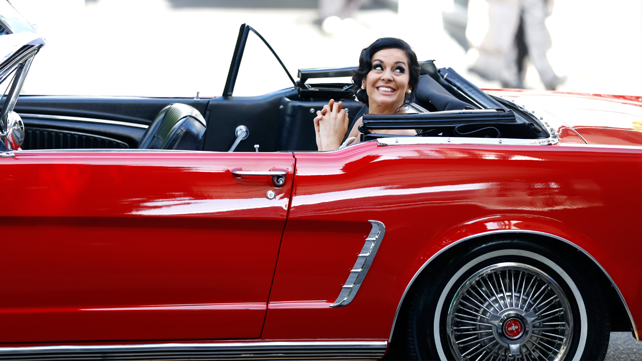 Christie arrives in her Mustang.