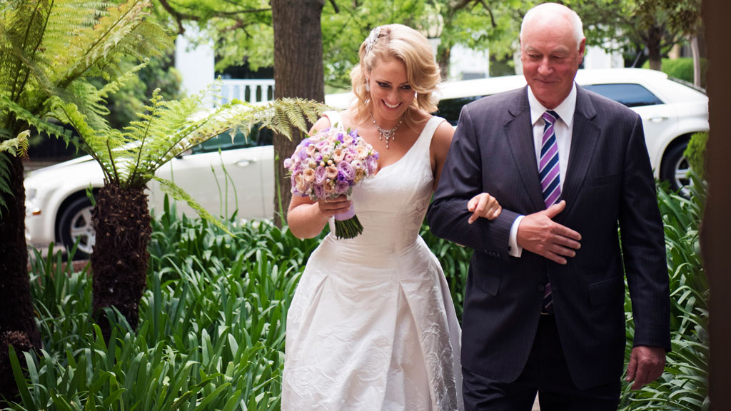 Clare makes her way to the altar with her dad.
