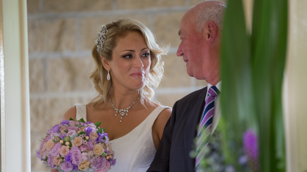 Clare and her dad enjoy a bit of marital humour before approaching the altar.