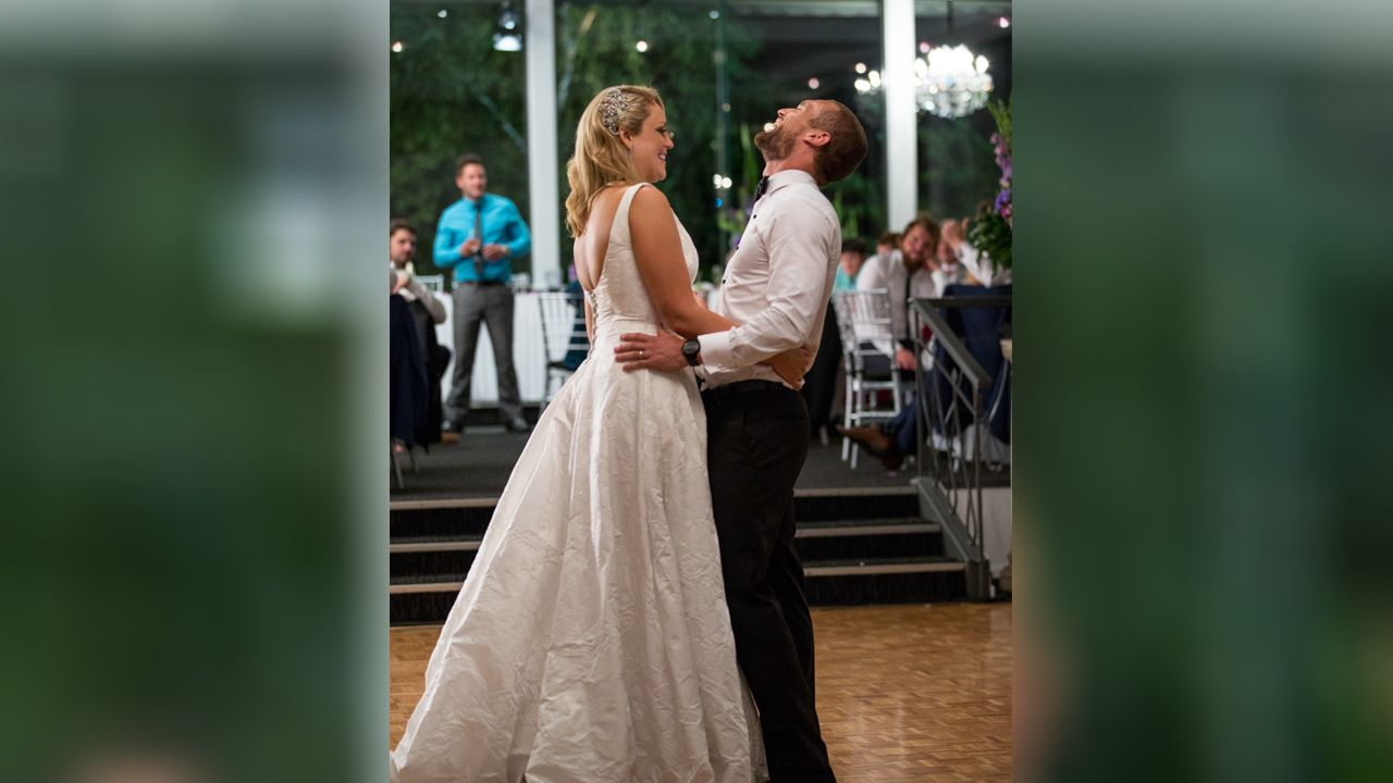 Jono's face starts to hurt from all of the smiling as he shares the first dance with Clare.