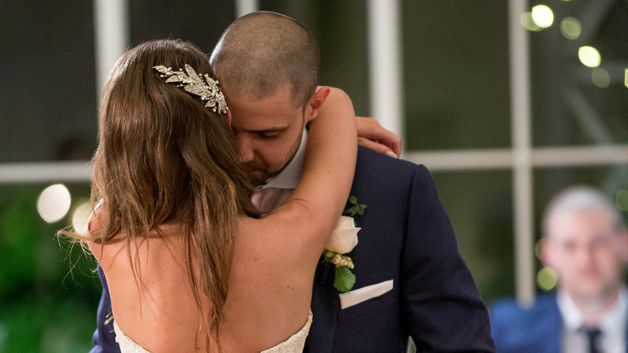Bryce and Erin share their first dance, and Bryce thanks Erin for not leaving him at the altar.