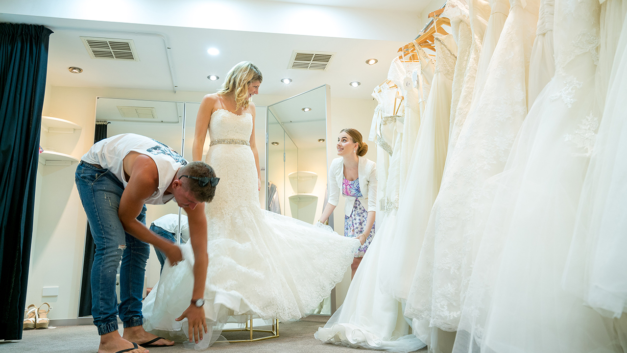 With some help, this bride tackles the tulle.