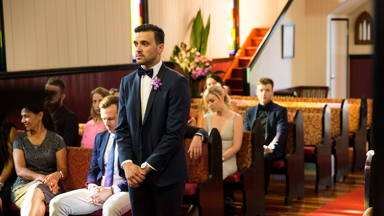 Michael waits patiently at the altar.