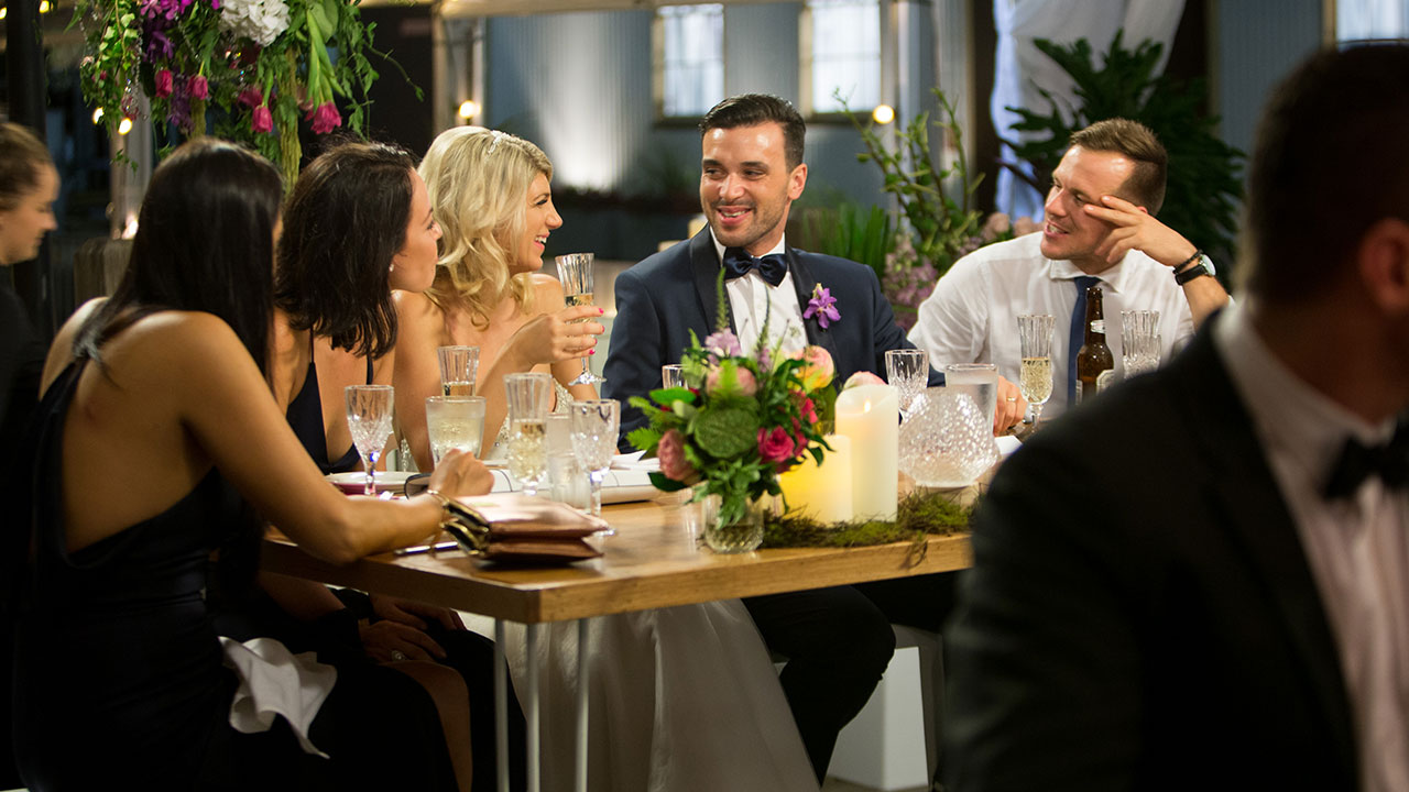 The new couple share a laugh at the bridal table.