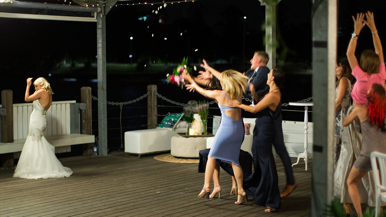 The bouquet toss has the ladies scrambling.