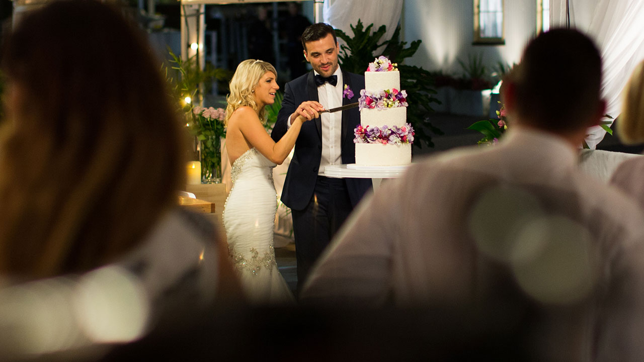 The new couple cut their magnificent cake.
