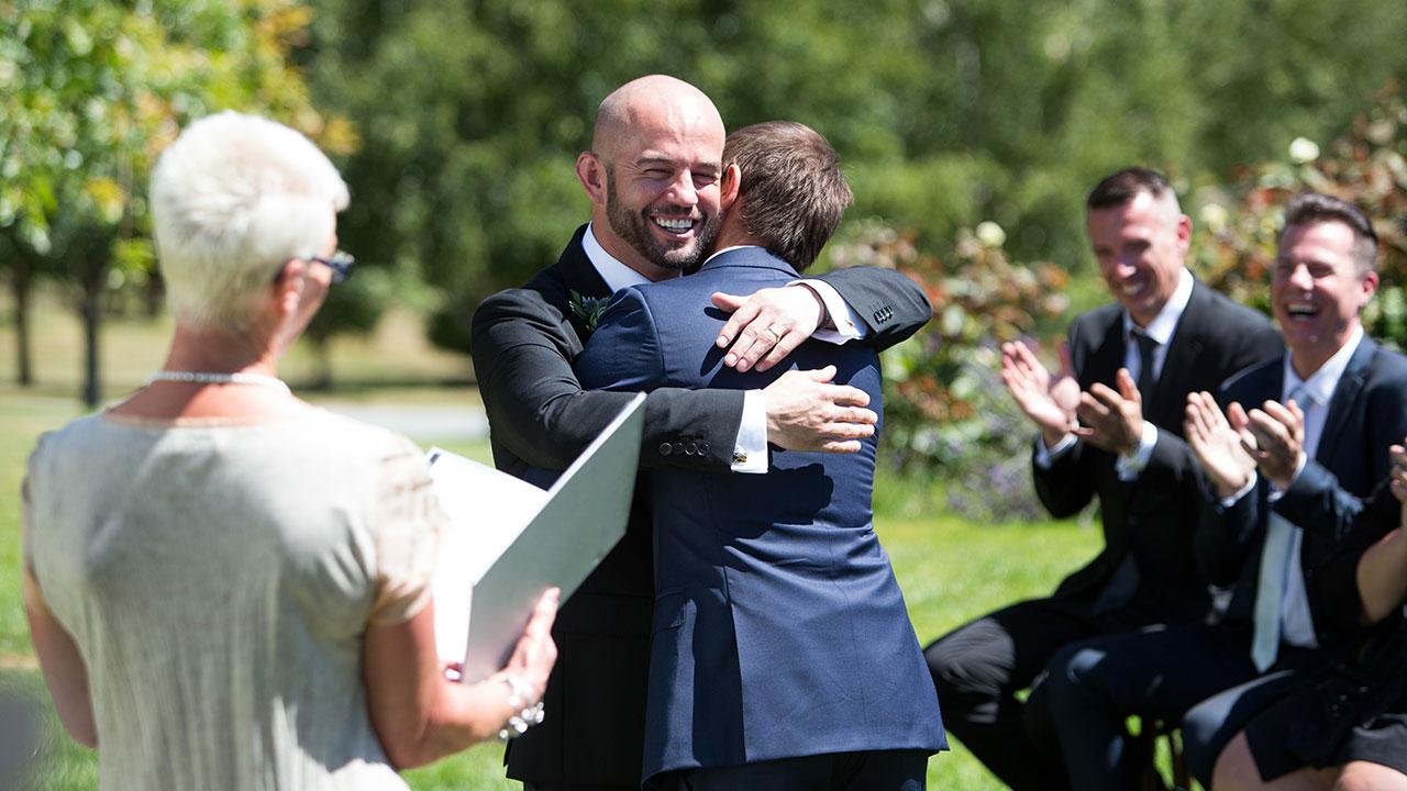 The couple share a kiss and a hug.