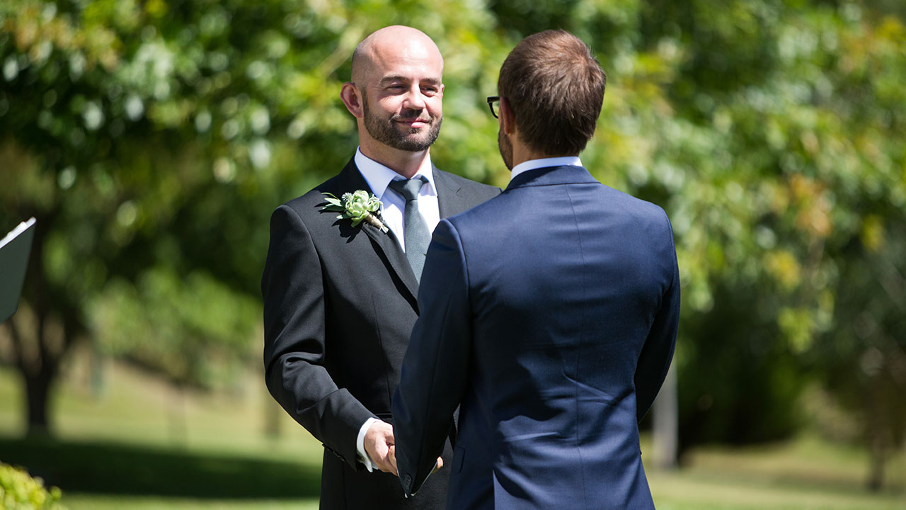 Andy and Craig exchange vows.