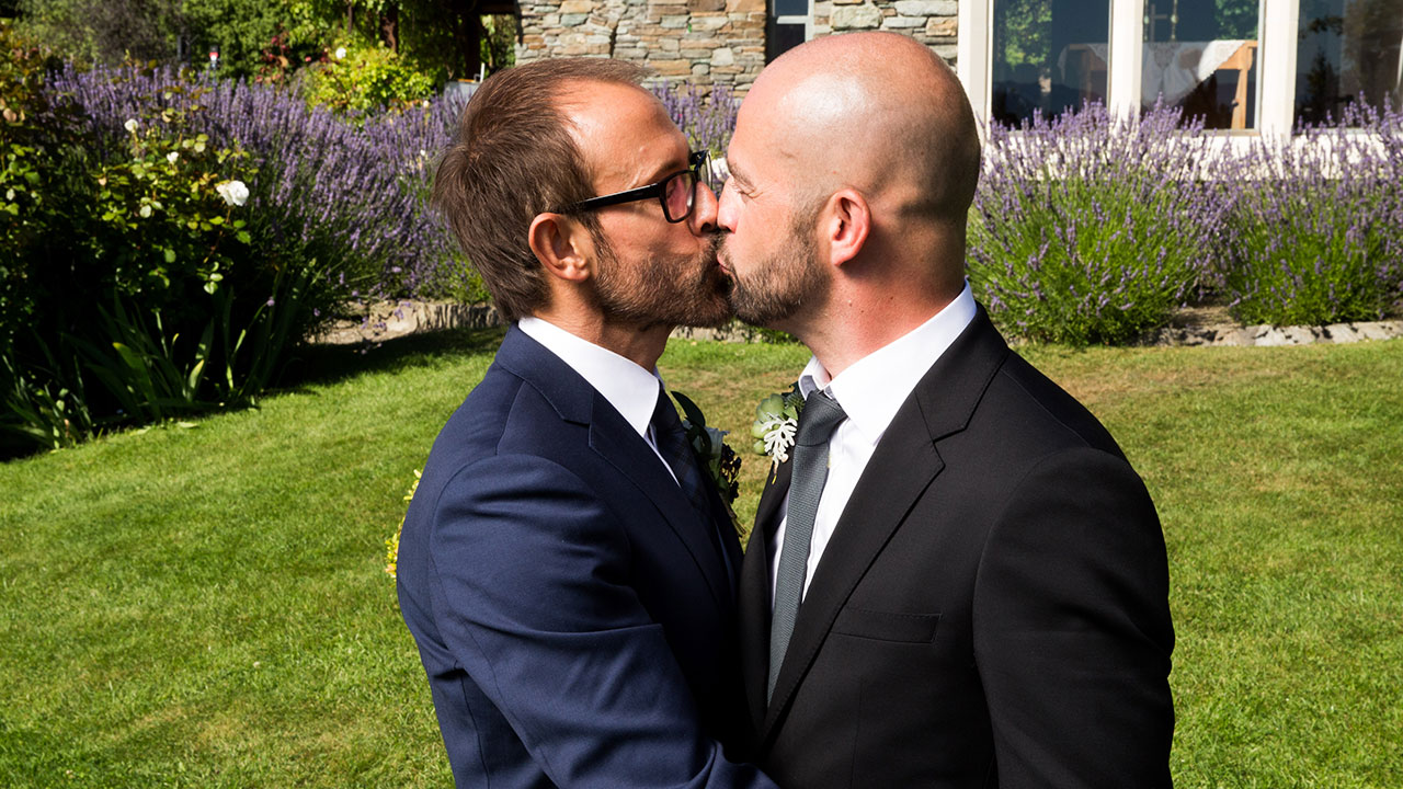 The happy couple share a kiss.