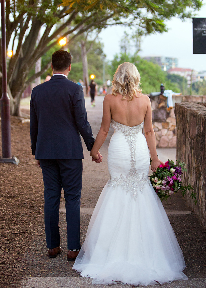 The new couple take a walk along the boardwalk..