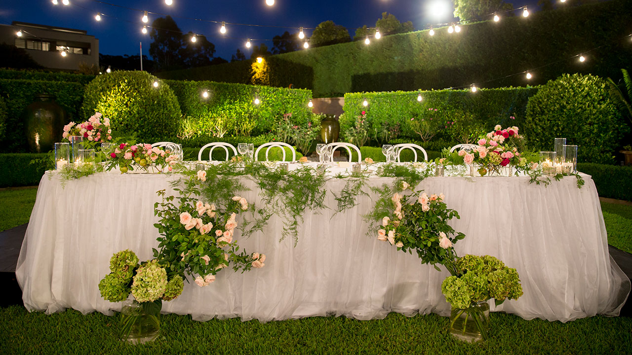 The stage is set for a frolicking  reception amongst the greenery.