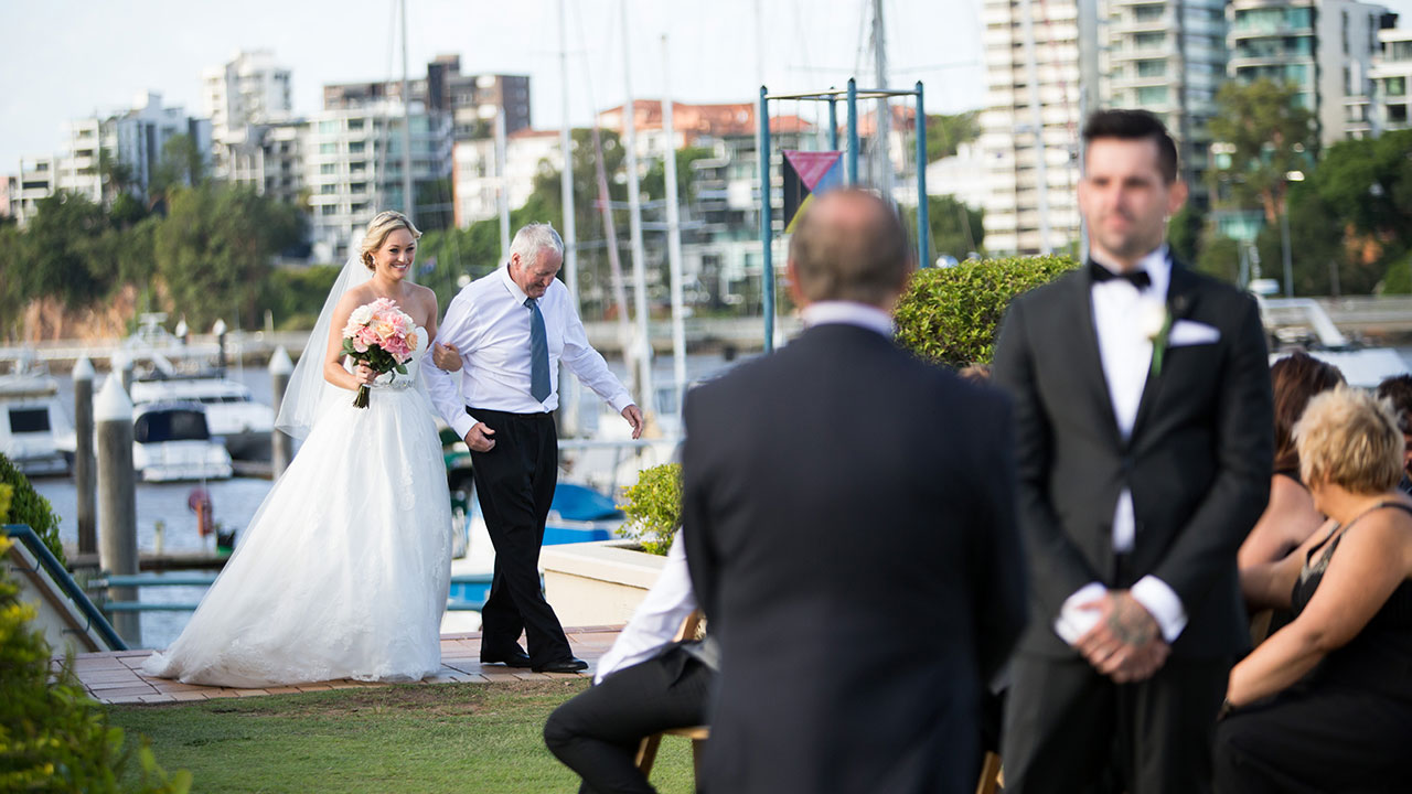 Nicole's dad, Mark, surprised her to walk her down the aisle.
