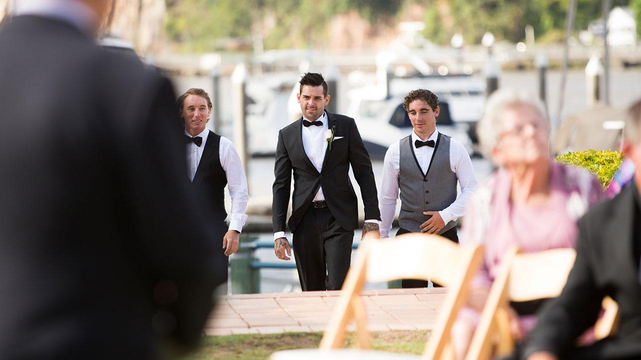 Keller arrives with his groomsmen.